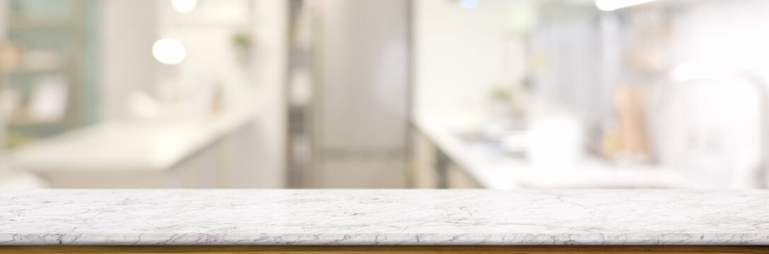 Cropped shot of empty marble table in blurred kitchen room