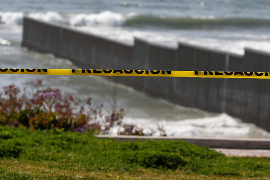 A police cordon tape is seen near the beach and the Mexico-U.S. border fence, after municipal beaches are closed as part of social distancing measures to control the spread of he coronavirus disease (COVID-19), in Tijuana