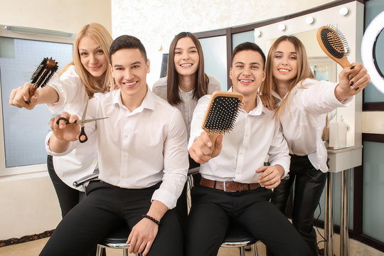 Young people during professional courses in hairdresser's salon