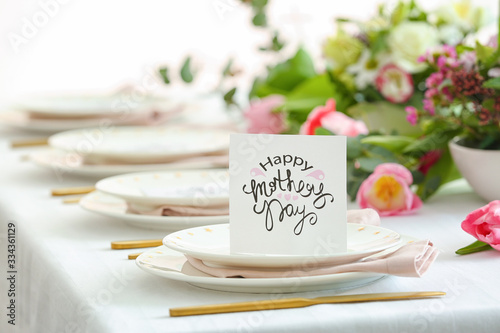 Table setting with card for Mother's day dinner