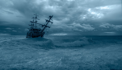 Poster Ship Sailing old ship in a storm sea in the background stormy clouds