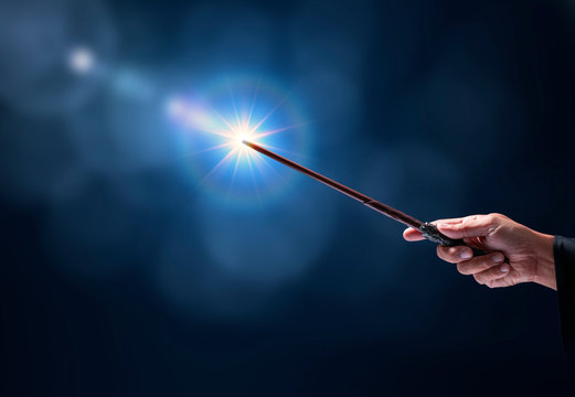 Magic wand with sparkle on miracle background, Miracle magical stick Wizard tool on hot background.