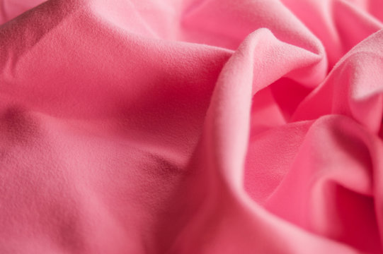 Close-up of pink microfiber towel for sports. Background, sportswear cloth