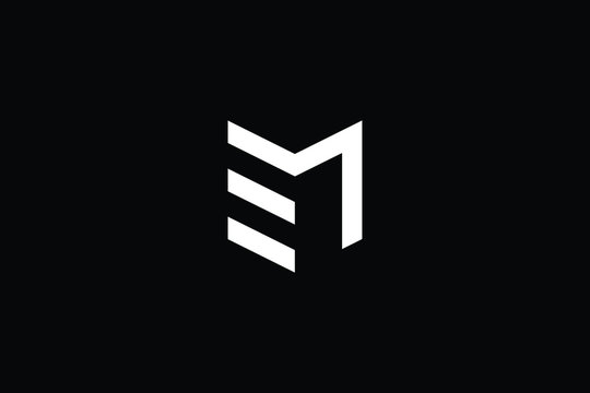 Logo design of M ME EM in vector for construction, home, real estate, building, property. Minimal awesome trendy professional logo design template on black background.