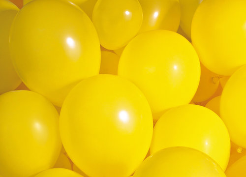 Group of yellow balloons create a background