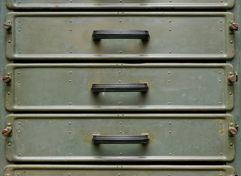 Old green metal closet with pullout drawers