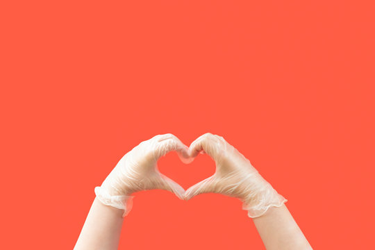 hands wearing latex gloves creating a heart shape