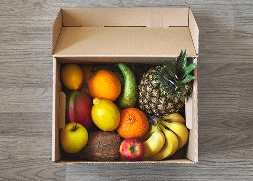 Fresh fruit delivery box on parquet floor