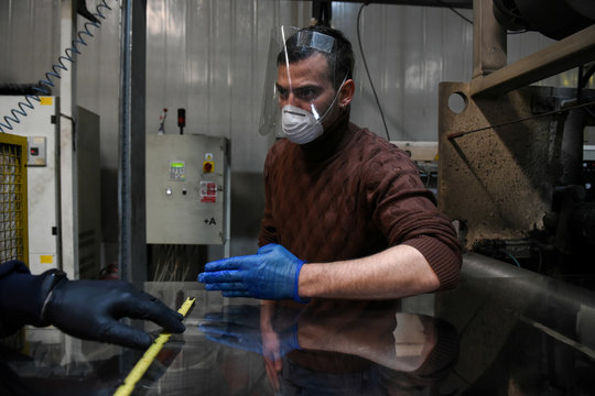 Product developer of Veltio startup company Theodoros Marioglou overlooks the production of face shields in a factory, following the outbreak of coronavirus disease (COVID-19) in Thessaloniki