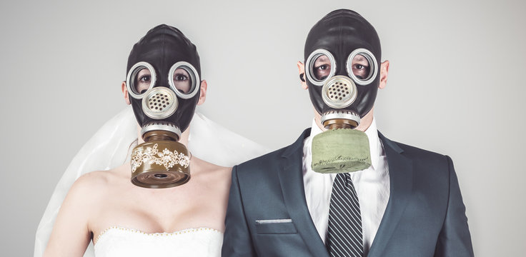 Wedding during the coronavirus period. Bride and groom in protective medical masks