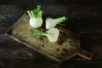 Raw vegetable on chopping board
