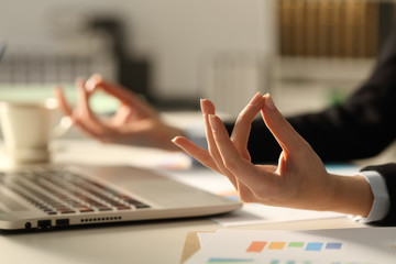 Executive hands relieving stress doing yoga at night