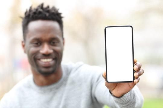 Happy black man showing phone screen mockup