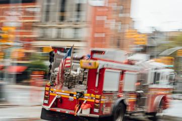 High-speed fire truck on a New York City street
