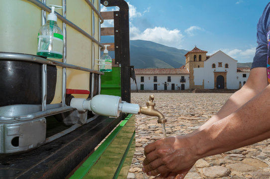 Sink in the main square of Villa de Leyva Boyacá Colombia is used by a man with the aim of preventing viral diseases such as the covid19 coronavirus