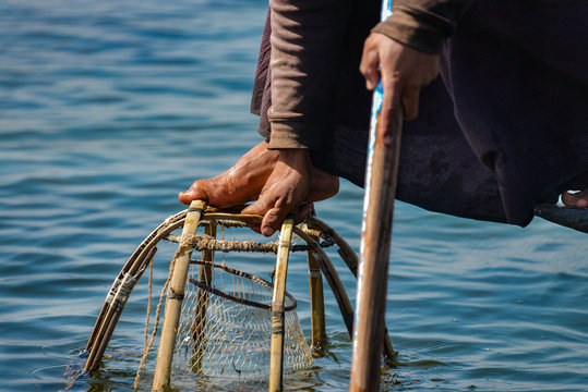 Fishing with a cone net where fish are trapped and then speared.