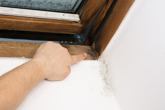 dark traces of moisture on the window pane, caused by insufficient ventilation, bad thermal insulation