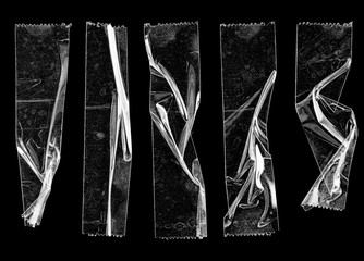 set of transparent adhesive tape or strips isolated on black background, crumpled plastic sticky snips, poster design overlays or elements. Fototapete