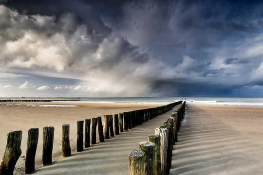 shower clouds over North sea beach