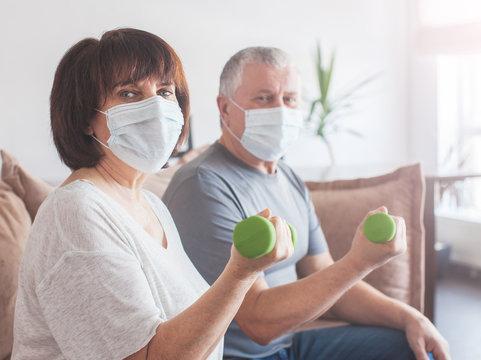 Elderly couple in medical masks during the pandemic coronavirus doing