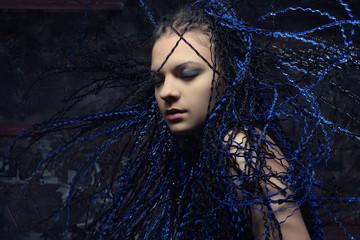 gothic woman with blue dreadlocks.