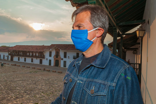 Latino ethnic man uses face masks to prevent the spread of diseases caused by the covid-19 coronavirus in the main plaza Villa de Leyva Boyacá Colombia totally alone due to quarantine