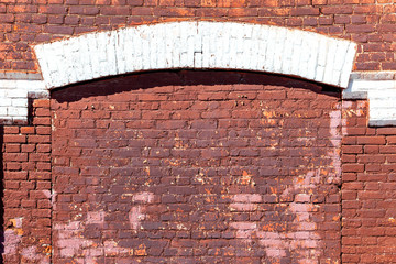Weathered red brick wall as background texture