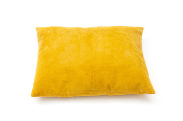 Yellow cushion close up on white background Wall mural