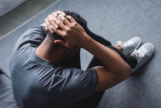 depressed african american man having panic attack at home