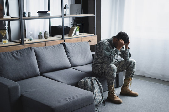 african american soldier in military uniform suffering from PTSD at home