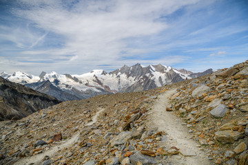 Wall Mural - Walking trail on Hohsaas with beautiful views on Fee glacier and surrounding massive above Saas-Fee village