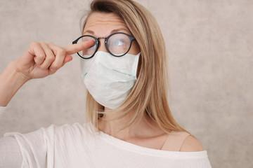 Medical mask and Glasses fogging. Avoid face touching, Coronavirus prevention, Protection. Fototapete