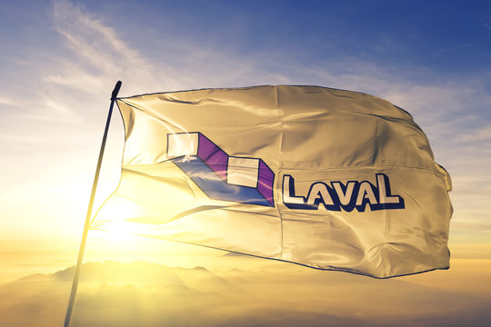 Laval of Quebec of Canada flag waving on the top sunrise mist fog