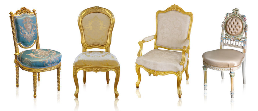 Set of golden armchairs isolated on white background