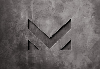 Pressed Logo Mockup on Dark Concrete Wall