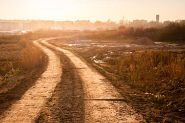 Wall Mural - Landscape of a dirt road near a city
