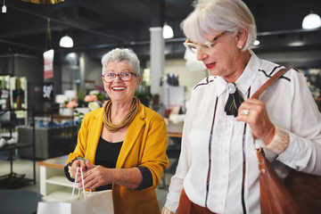 Senior women friends shopping