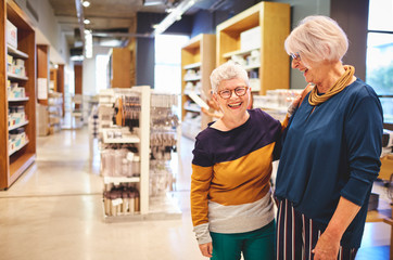 Portrait happy laughing senior women friends in home goods store