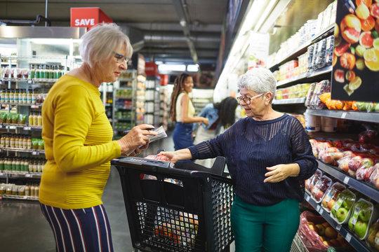 Senior women grocery shopping in supermarket
