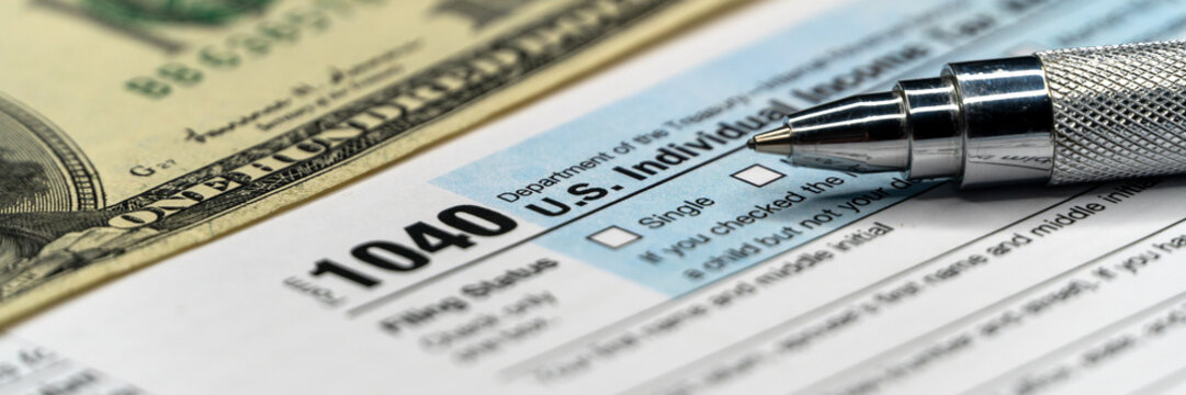 Detail closeup of current tax forms for IRS filing. Tax time