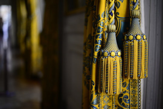 detail of a yellow tassel at the Palace of Versailles