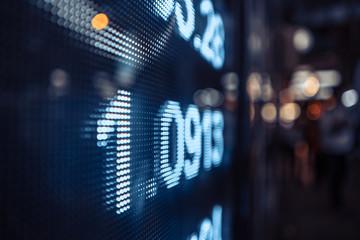 Display stock market numbers with defocused street lights background Fototapete