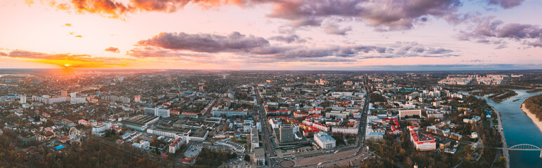 Foto auf Leinwand Lavendel Gomel, Belarus. Aerial View Of Homiel Cityscape Skyline In Autumn Evening. Residential District And River During Sunset. Bird's-eye View. Panorama, Panoramic View