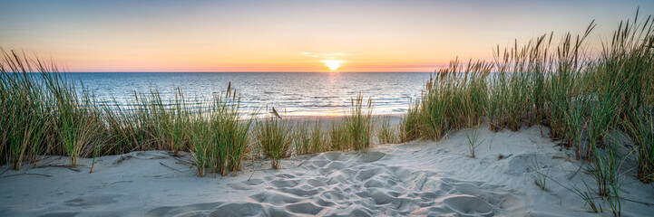 Acrylic Prints Coast Sunset at the dune beach