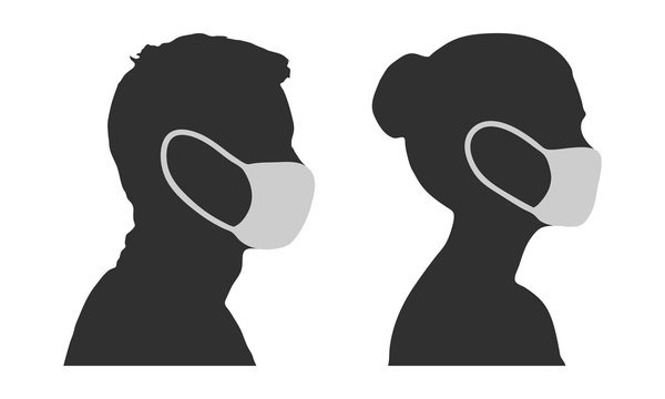 Silhouette of man and woman in disposable face masks for protection against the virus.