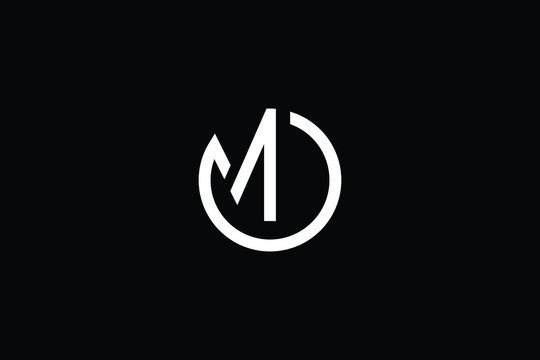 Minimal elegant monogram art logo. Outstanding professional trendy awesome artistic MO OM initial based Alphabet icon logo. Premium Business logo White color on black background
