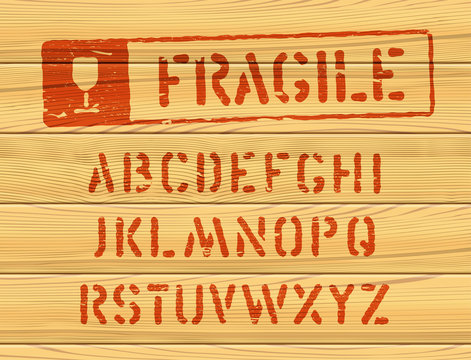 Military effect industrial typeset. Fragile freight distressed font. Typeset with rough edged letters. Typography on wooden box texture. Red stamp for container delivery