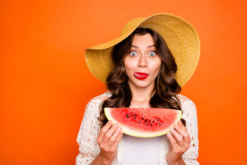 Photo of casual white brown haired charming curly wavy nice pretty girlfriend licking upper lip being tempted watermelon cannot wait to eat wearing cap headwear isolated vivid color background Wall mural