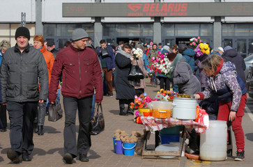 Women sell vegetables and artificial flowers at an illegal market amid coronavirus disease (COVID-19) outbreak