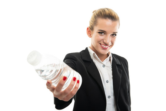 Portrait of beautiful young female assistant manager offering water